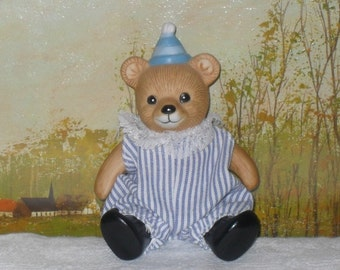 Vintage jointed china bear with party hat and removable clothes