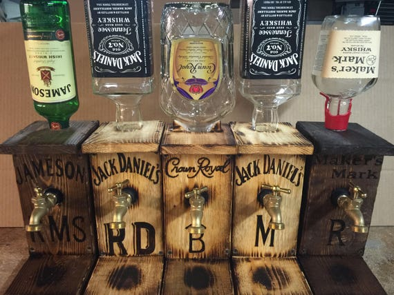 Looking for a lame personalized Father's Day gift? These personalized liquor dispensers are not that. Heh.
