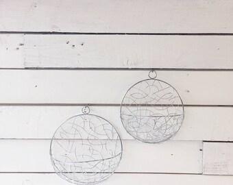 Set of 2 metal circular wall pocket hangers