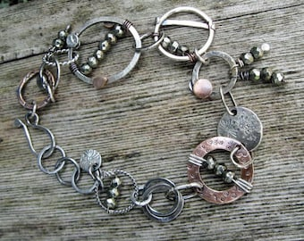 Hand formed copper and sterling silver hoops bracelet with faceted pyrite beads