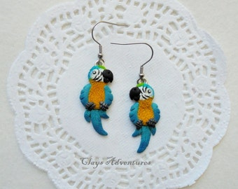 Parrot funny earrings blue and gold macaw ararauna handmade from polymer clay.