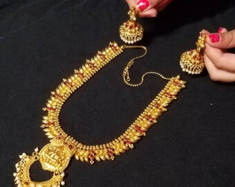 Mid length gold and ruby haram