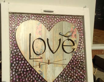 Vintage glass window with wood plaque of love, pink signing stones