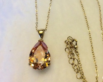 Teardrop shaped cubic zirconia in gold setting necklace