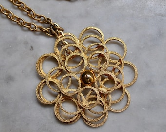 Gold Dangly Flower Pendant with Long Chain