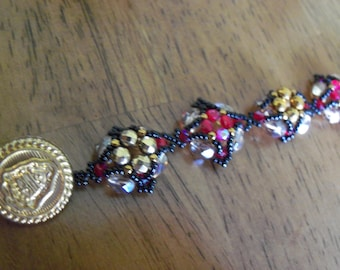 Gold, black and red bracelet with handmade button toggle clasp