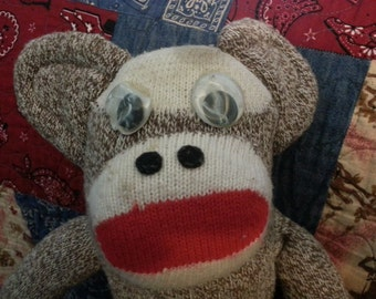 Vintage toy sock monkey with character
