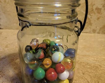 Vintage set of approximately 80 antique estate found marbles in old ball canning jar.