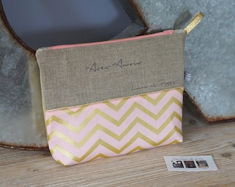 Customizable graphic toiletry bag in natural linen and cotton coral and gold