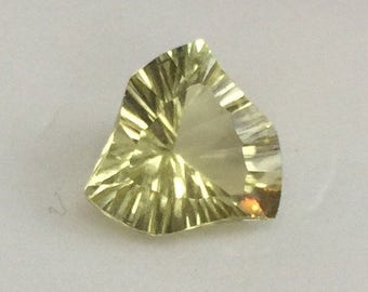 Citrine, artistically faceted gemstone.
