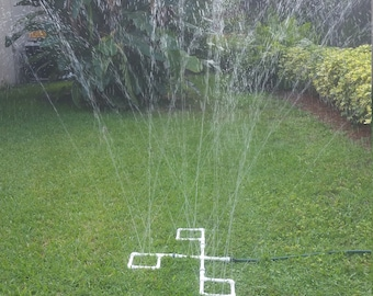 Outdoor Water Play Sprinkler Fun for Kids. Includes the 4-way Hub and 3 attachments with all connectors and plugs.