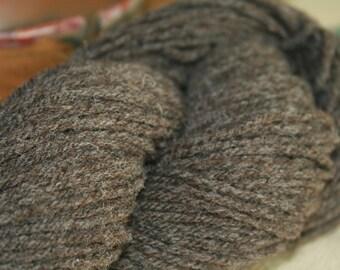 Merino wool yarn, natural medium gray, 3 ply worsted weight, 190 yards.