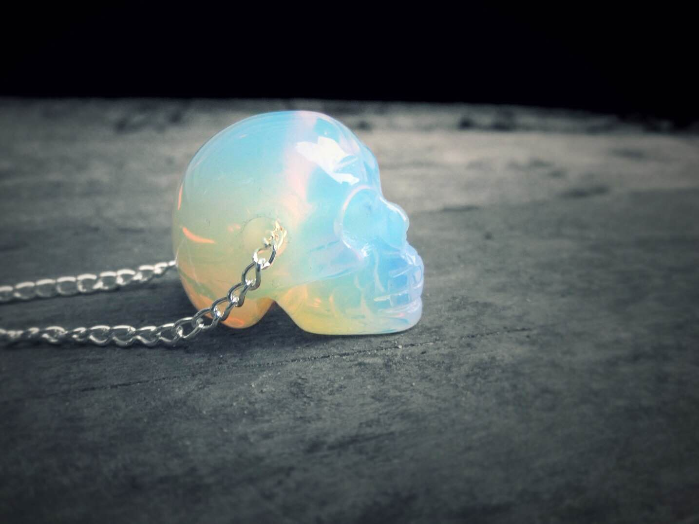 Crystal skull necklace holographic opalite skull opal zoom mozeypictures Image collections