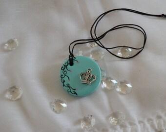 Pretty round ceramic pendant