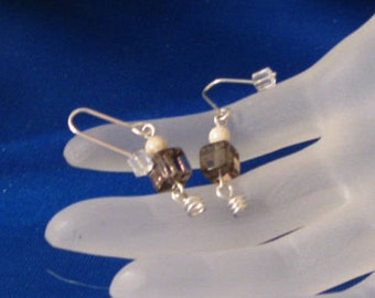 Smokie Earrings. Artistically simple, a little whimsical, a lot appealing!