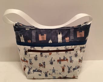 "LIP14- Lunch Bag: ""Knight and Day"" washable insulated lunch bag with zippered front pocket and zippered top closure."