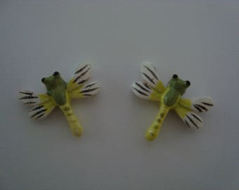 Set of two dragonflies in shades of green for decoration