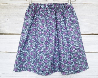 Blue skirt in purple and blue flowers.