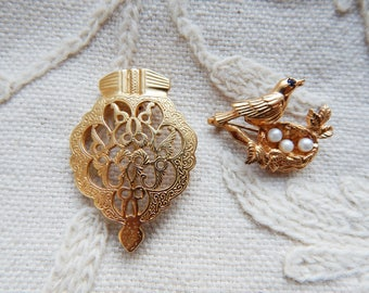 A Pair of Brooches in Gilded Solid Silver - Stamped to Reverse - Bird with Nest and an Ornate Cartouche - 15g
