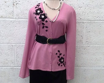 Statement vintage pink cardigan with black flower design