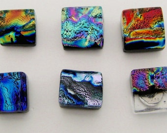 Single dichroic glass tiny post earrings.