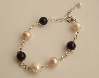 Wire Wrapped Black Onyx, White and Soft Purple Fresh Water Pearls with S Links Sterling Silver Bracelet