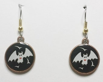 Halloween Bats with Eyes White bats with a black backround