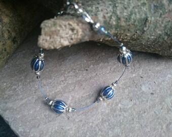 Blue wire and enamel bead bracelet