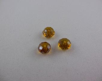 Round flattened Swarovski Topaz color beads
