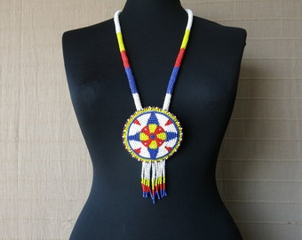 Tribal and modern beaded necklace with a pendant