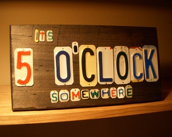 Its 5'OCLOCK somewhere sign made with recycled license plates.