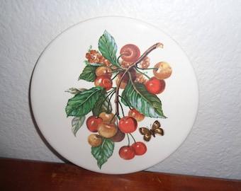 Vintage Round Trivet with Cherry Cherries on it