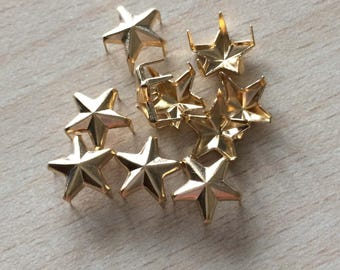 Gold tone star claw nails