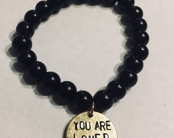 Customizable hand stamped gold brass endant bracelet with black glass beads