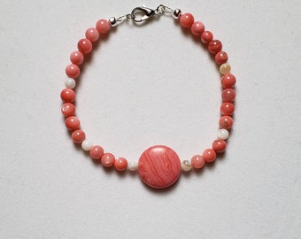 Handmade beaded bracelet for women with white and pink shell beads.