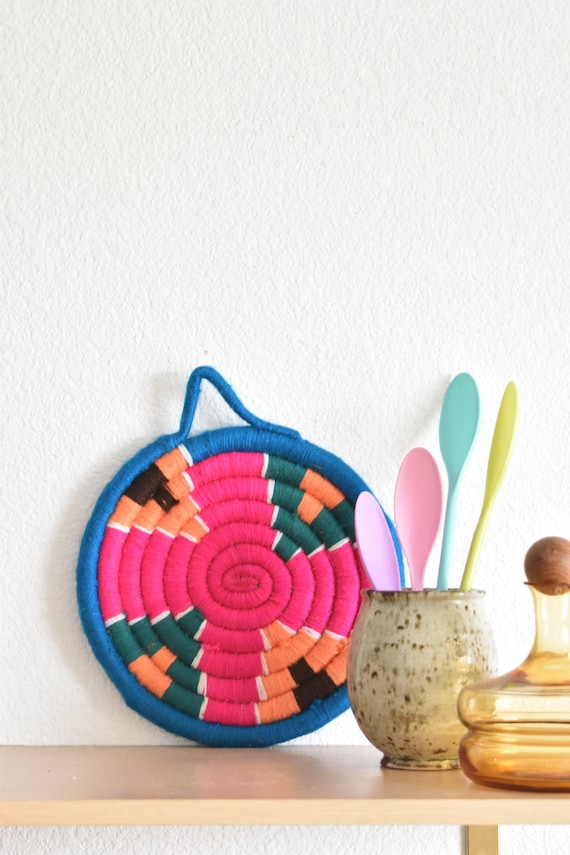 bright pink woven coiled wall hanging basket | patterned blue