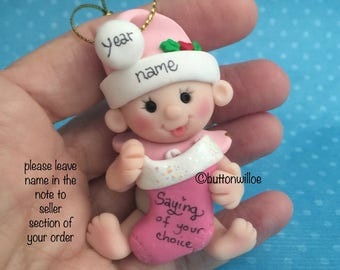 Pink, blue or green Baby's First Christmas 2nd Christmas 3rd Christmas Personalized ornament holding Christmas Stocking with gift box
