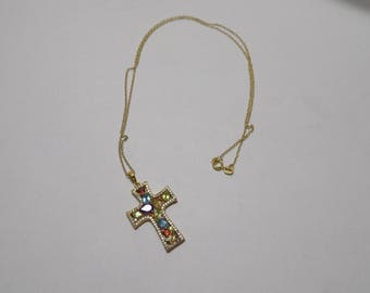 Beautiful gold tone sterling sliver gemstone covered cross
