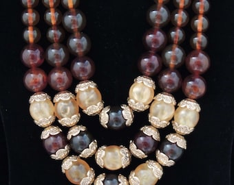 Stunning Vintage Multi Strand Amber Color and Swirled Gold Lucite Bead Necklace / Multi Strand Bead Necklace / Graduated Bead Necklace