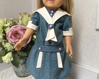 Blue drop waist dress with pink rosebud pattern.