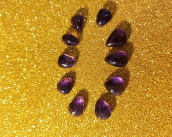Lot of 10 amethyst assorted cabochons. Ring size.