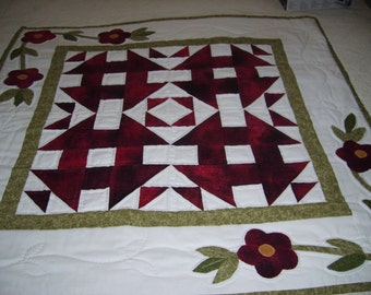 Appliqued wall hanging,pieced blocks, hand quilted,