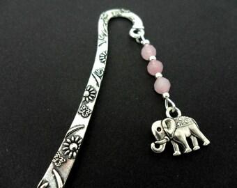 A tibetan silver elephant and pink jade beads bookmark.