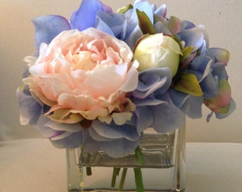 silk flower arrangement, faux flower arrangement in acrylic water, blue hydrangea, peach peonies, square vase, mothers day