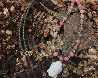 Rhodonite necklace with brass metal beads, hematite accents, and natural carved Buddha bead