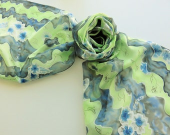 "Hand painted silk scarf. Handpainted silk scarf. Green black and grey scarf. Green silk scarf with blue flowers. 17 x 71"", 45 x 180 cm."