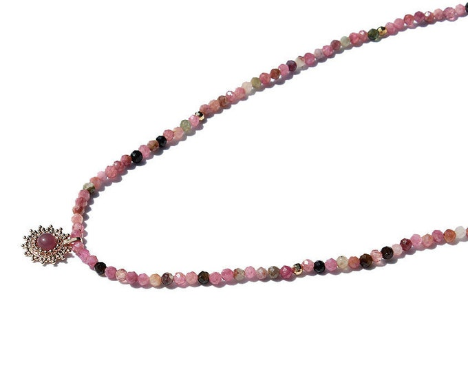 tourmaline gems and a pendant necklace