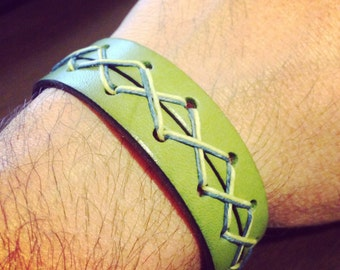 Handmade Apple Green Unisex Leather Cuff with Pale Yellow & Light Blue Linen Criss Cross Stitching and a Gold Magnetic Closure