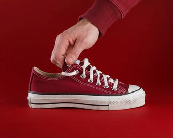 Converse Chuck Taylor All Star low top vintage sneakers. Made in USA. Size US mens 4,5, womens 6, 24,5 cm, EU 37. Maroon color.