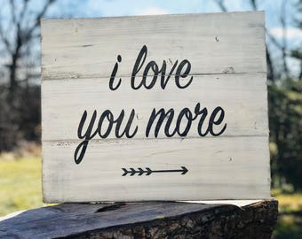 I Love You More black and white wood sign